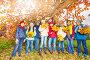 Дети с желтыми кленовыми листьями в осеннем лесу, фото № 6751112, снято 12 октября 2014 г. (c) Сергей Новиков / Фотобанк Лори