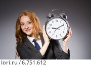 Купить «Businesswoman with clock being late for her deliverables», фото № 6751612, снято 20 декабря 2013 г. (c) Elnur / Фотобанк Лори