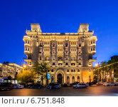 Купить «Baku - MAY 5, 2014: Illuminated building in the city center on May 5 in Azerbaijan, Baku. Baku is becoming a popular tourist destination», фото № 6751848, снято 5 мая 2014 г. (c) Elnur / Фотобанк Лори