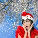 Красивая девушка в шапке Санта Клауса на фоне зимней природы, фото № 6753676, снято 7 февраля 2013 г. (c) ElenArt / Фотобанк Лори