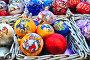 Яркие новогодние елочные шары с символом 2015 года - козой, эксклюзивное фото № 6755540, снято 3 декабря 2014 г. (c) lana1501 / Фотобанк Лори