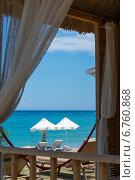 Купить «Красивый вид на морской берег с зонтиками от солнца из окна дома», фото № 6760868, снято 21 июня 2014 г. (c) Володина Ольга / Фотобанк Лори