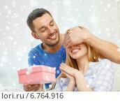 Купить «smiling man surprises his girlfriend with present», фото № 6764916, снято 9 февраля 2014 г. (c) Syda Productions / Фотобанк Лори