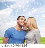 Купить «smiling girlfriend telling boyfriend secret», фото № 6764924, снято 9 февраля 2014 г. (c) Syda Productions / Фотобанк Лори