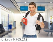 Купить «smiling student with backpack and book at airport», фото № 6765212, снято 8 апреля 2012 г. (c) Syda Productions / Фотобанк Лори