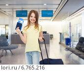 Купить «smiling girl with travel bag ticket and passport», фото № 6765216, снято 30 апреля 2014 г. (c) Syda Productions / Фотобанк Лори