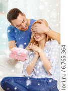 Купить «smiling man surprises his girlfriend with present», фото № 6765364, снято 9 февраля 2014 г. (c) Syda Productions / Фотобанк Лори