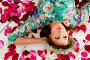 Девушка лежит в розовых лепестках, эксклюзивное фото № 6774504, снято 8 октября 2014 г. (c) Куликова Вероника / Фотобанк Лори