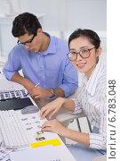 Купить «Creative team working at desk», фото № 6783048, снято 28 мая 2014 г. (c) Wavebreak Media / Фотобанк Лори