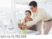 Купить «Creative team working at desk», фото № 6783068, снято 28 мая 2014 г. (c) Wavebreak Media / Фотобанк Лори