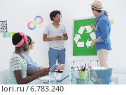Купить «Young creative team having a meeting about recycling», фото № 6783240, снято 28 мая 2014 г. (c) Wavebreak Media / Фотобанк Лори