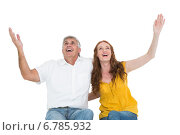 Купить «Casual couple smiling with arms raised», фото № 6785932, снято 25 июня 2014 г. (c) Wavebreak Media / Фотобанк Лори