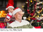 Купить «Son surprising his father with christmas gift», фото № 6786524, снято 27 августа 2014 г. (c) Wavebreak Media / Фотобанк Лори