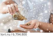 Купить «man emptying jar with white and wild black rice», фото № 6794800, снято 21 января 2014 г. (c) Syda Productions / Фотобанк Лори