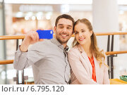 Купить «happy couple with smartphone taking selfie in mall», фото № 6795120, снято 10 ноября 2014 г. (c) Syda Productions / Фотобанк Лори