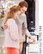 Купить «happy couple choosing engagement ring in mall», фото № 6795144, снято 10 ноября 2014 г. (c) Syda Productions / Фотобанк Лори
