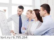 Купить «business team discussing something in office», фото № 6795264, снято 5 апреля 2014 г. (c) Syda Productions / Фотобанк Лори