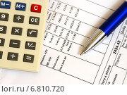 Купить «Коммунальные платежи. Квитанция, ручка и калькулятор», эксклюзивное фото № 6810720, снято 17 декабря 2014 г. (c) Юрий Морозов / Фотобанк Лори