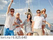 Купить «smiling friends sailing on yacht», фото № 6825640, снято 13 июля 2014 г. (c) Syda Productions / Фотобанк Лори