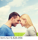 Купить «smiling couple looking at each other», фото № 6826056, снято 9 февраля 2014 г. (c) Syda Productions / Фотобанк Лори
