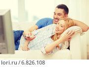 Купить «smiling couple watching movie at home», фото № 6826108, снято 9 февраля 2014 г. (c) Syda Productions / Фотобанк Лори