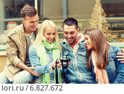 Купить «group of smiling friends with digital photocamera», фото № 6827672, снято 14 июня 2014 г. (c) Syda Productions / Фотобанк Лори