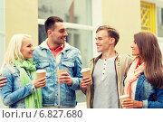 Купить «group of smiling friends with take away coffee», фото № 6827680, снято 14 июня 2014 г. (c) Syda Productions / Фотобанк Лори