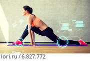 Купить «smiling woman stretching leg on mat in gym», фото № 6827772, снято 7 июня 2014 г. (c) Syda Productions / Фотобанк Лори