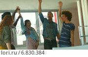 Купить «Students putting hands together in college», видеоролик № 6830384, снято 29 марта 2020 г. (c) Wavebreak Media / Фотобанк Лори