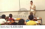 Купить «Pupils listening to their teacher at chalkboard», видеоролик № 6830684, снято 29 марта 2020 г. (c) Wavebreak Media / Фотобанк Лори