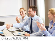 Купить «smiling business team shaking hands in office», фото № 6832704, снято 25 октября 2014 г. (c) Syda Productions / Фотобанк Лори
