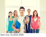 Купить «male student with classmates showing thumbs up», фото № 6833056, снято 4 мая 2014 г. (c) Syda Productions / Фотобанк Лори