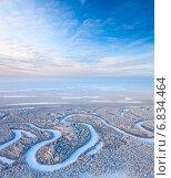 Купить «Вид сверху на зимний лес с рекой», фото № 6834464, снято 20 января 2012 г. (c) Владимир Мельников / Фотобанк Лори