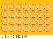Купить «Фон из апельсиновых ломтиков», фото № 6842216, снято 19 декабря 2010 г. (c) MMISTUDIO / Фотобанк Лори