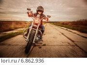 Biker girl on a motorcycle. Стоковое фото, фотограф Андрей Армягов / Фотобанк Лори