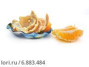 Купить «Апельсин очищенный», фото № 6883484, снято 5 января 2015 г. (c) Parmenov Pavel / Фотобанк Лори