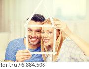 Купить «smiling couple with house from measuring tape», фото № 6884508, снято 9 февраля 2014 г. (c) Syda Productions / Фотобанк Лори