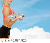 Купить «close up of sporty woman with heavy steel dumbbell», фото № 6884820, снято 8 мая 2014 г. (c) Syda Productions / Фотобанк Лори