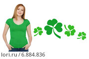 Купить «smiling teen girl in green t-shirt with shamrock», фото № 6884836, снято 4 мая 2014 г. (c) Syda Productions / Фотобанк Лори