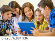 Купить «group of kids with teacher and tablet pc at school», фото № 6884936, снято 15 ноября 2014 г. (c) Syda Productions / Фотобанк Лори