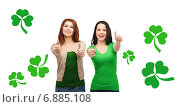 Купить «two smiling girls showing thumbs up with shamrock», фото № 6885108, снято 27 ноября 2013 г. (c) Syda Productions / Фотобанк Лори