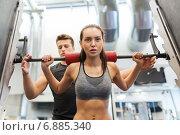 Купить «man and woman with barbell flexing muscles in gym», фото № 6885340, снято 30 ноября 2014 г. (c) Syda Productions / Фотобанк Лори