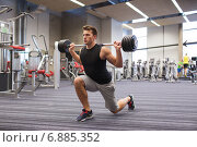 Купить «young man flexing muscles with barbell in gym», фото № 6885352, снято 30 ноября 2014 г. (c) Syda Productions / Фотобанк Лори