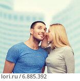 Купить «smiling girlfriend telling boyfriend secret», фото № 6885392, снято 9 февраля 2014 г. (c) Syda Productions / Фотобанк Лори