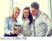 Купить «business team working with tablet pc in office», фото № 6886708, снято 23 ноября 2013 г. (c) Syda Productions / Фотобанк Лори
