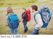 Купить «group of smiling friends with backpacks hiking», фото № 6886916, снято 31 августа 2014 г. (c) Syda Productions / Фотобанк Лори