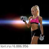 Купить «sporty woman with heavy steel dumbbells», фото № 6886956, снято 8 мая 2014 г. (c) Syda Productions / Фотобанк Лори