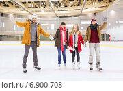 Купить «happy friends waving hands on skating rink», фото № 6900708, снято 26 ноября 2014 г. (c) Syda Productions / Фотобанк Лори
