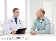 Купить «doctor with clipboard and patient in hospital», фото № 6901156, снято 10 мая 2014 г. (c) Syda Productions / Фотобанк Лори