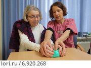 Купить «Flensburg, Germany, occupational therapist makes exercises with a patient with plasticine», фото № 6920268, снято 6 марта 2014 г. (c) Caro Photoagency / Фотобанк Лори